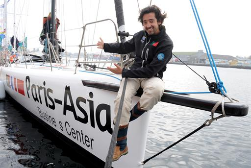 """Portuguese skipper Ricardo Diniz poses aboard his Class Rhum ParisAsia fr on October 29, 2014 in Saint Malo, western France before the 10th edition of the Route du Rhum sailing race to start on November 2, 2014. The """"Route du Rhum - Destination Guadeloupe"""" is a solo race held every four years between Saint-Malo to Pointe-à-Pitre. AFP PHOTO / JEAN-FRANCOIS MONIER"""